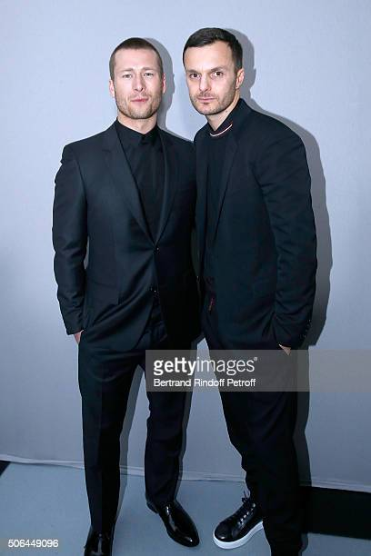 Actor Glen Powell and Fashion designer Kris Van Assche pose Backstage after the Dior Homme Menswear Fall/Winter 20162017 show as part of Paris...