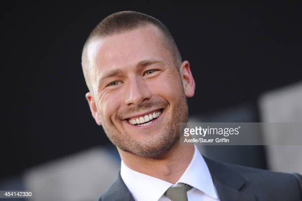 Actor Glen Powell arrives at the Los Angeles premiere of 'The Expendables 3' at TCL Chinese Theatre on August 11 2014 in Hollywood California