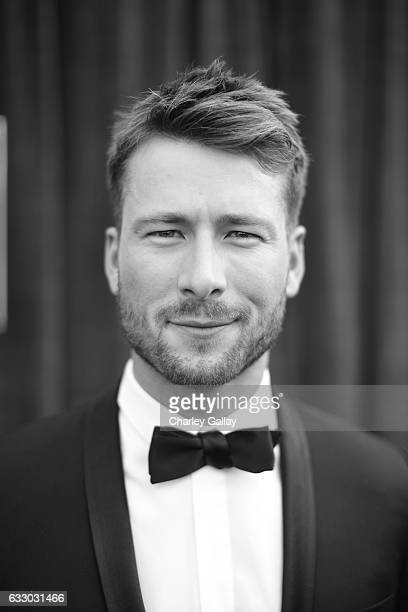 Image has been shot in black and white Color version not available Actor Glen Powell attends The 23rd Annual Screen Actors Guild Awards at The Shrine...