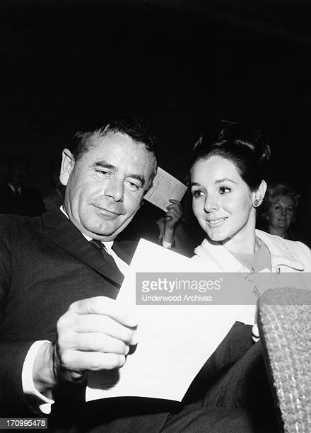 Actor Glenn Ford and actress Kathy Hays at a Ken Murray 'home movies' screening They were married two years later Hollywood California 1964