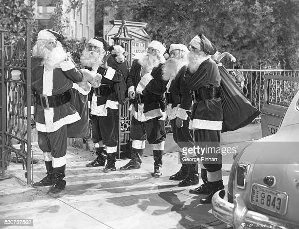Actor Glenn Ford dressed as Santa Claus in the 1949 film Mr Soft Touch