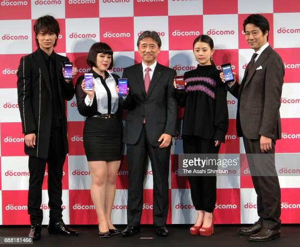 Actor Go Ayano comedian Buruzon Chiemi NTT DoCoMo President Kazuhiro Yoshizawa actress Mitsuki Takahata and actor Shinichi Tsutsumi pose during the...