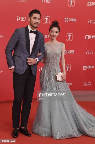 Actor Godfrey Gao and actress Wang Likun arrive at the red carpet of the 20th Shanghai International Film Festival on June 17 2017 in Shanghai China