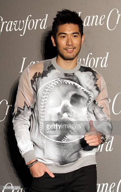 Actor Godfrey Gao attends Lane Crawford flagship store opening ceremony at Shanghai Times Square on October 23 2013 in Shanghai China