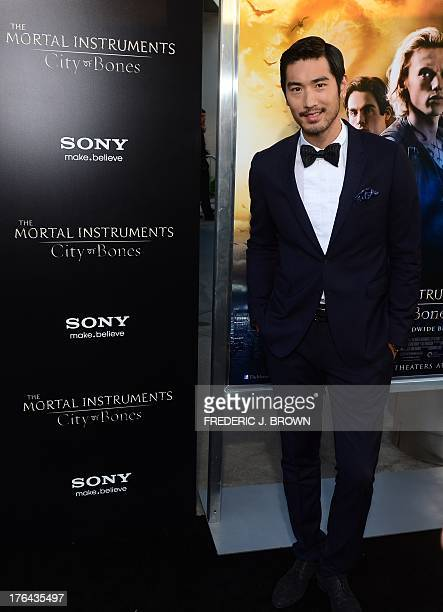 Actor Godfrey Gao poses on arrival for the premiere of the film 'Mortal Instruments City of Bones' in Hollywood California on August 12 2013 The film...