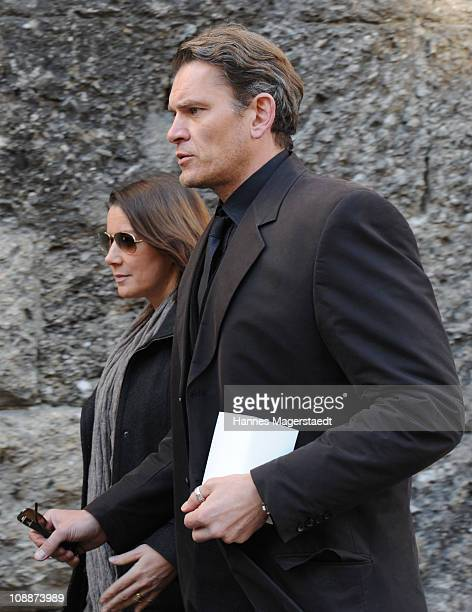 Actor Goetz Otto and his wife Sabine attend the memorial service for Bernd Eichinger at the St Michael Kirche on February 07 2011 in Munich Germany...