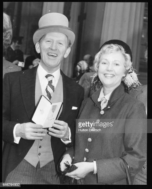 Actor Gordon Jackson with his wife Rhona Anderson at Buckingham Palace after receiving a medal from the Queen 1979