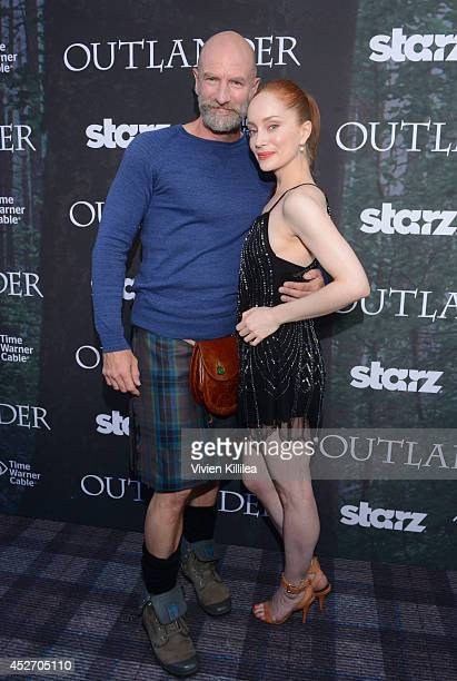 Actor Graham McTavish and actress Lotte Verbeek attend the Starz Series Outlander Premiere ComicCon International 2014 at Spreckels Theatre on July...