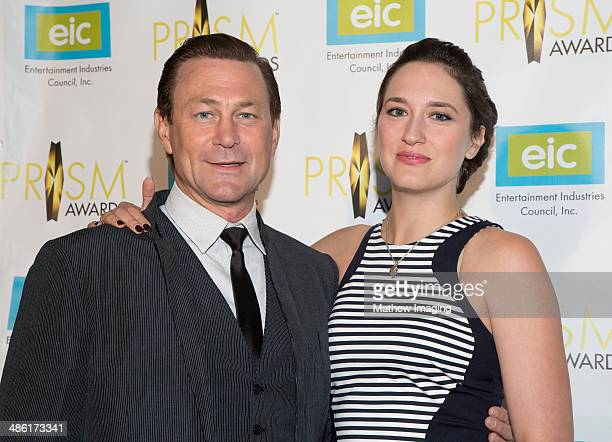 Actor Grant Bowler and a guest arrive at the 18th Annual PRISM Awards at Skirball Cultural Center on April 22, 2014 in Los Angeles, California.