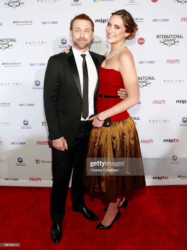 Actor Grant Bowler and guest attend the 40th International Emmy Awards at Mercury Ballroom at the New York Hilton on November 19, 2012 in New York City.