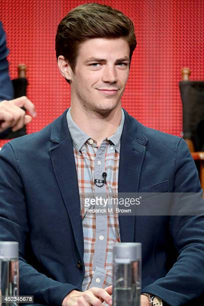Actor Grant Gustin speaks onstage at the 'The Flash' panel during the CW Network portion of the 2014 Summer Television Critics Association at The...
