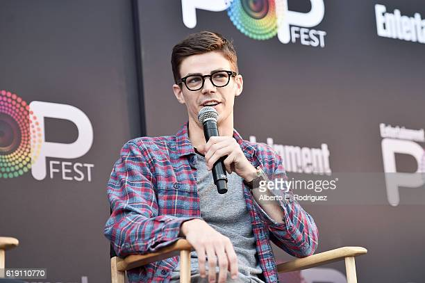 "Actor Grant Gustin speaks onstage during the ""CW Superheroes"" panel at Entertainment Weekly's PopFest at The Reef on October 29 2016 in Los Angeles..."