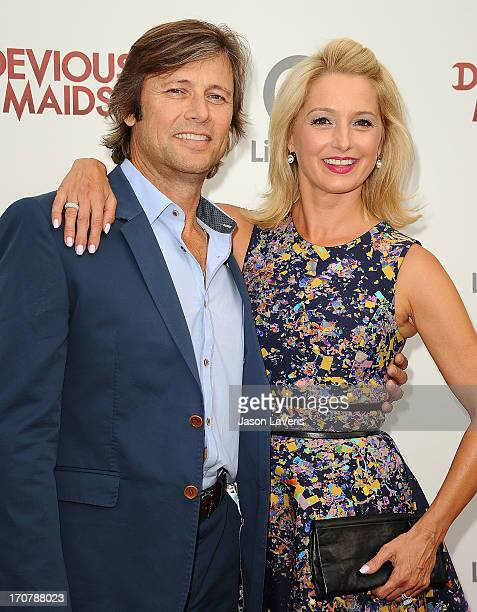Actor Grant Show and actress Katherine LaNasa attend the premiere of Devious Maids at BelAir Bay Club on June 17 2013 in Beverly Hills California