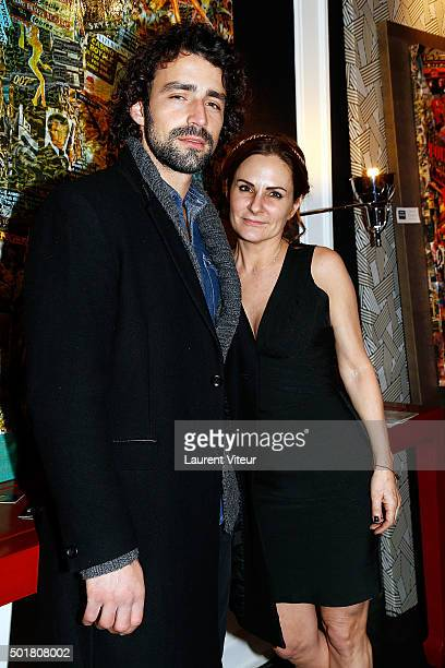 Actor Gray Orsatelli and Anne Mondy attend 'Accords Croises' Anne Mondy's exhibition at Rue Bonaparte on December 17 2015 in Paris France