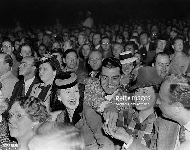 Actor Greg Bautzer and actress Lana Turner laugh during an event in Los Angeles California