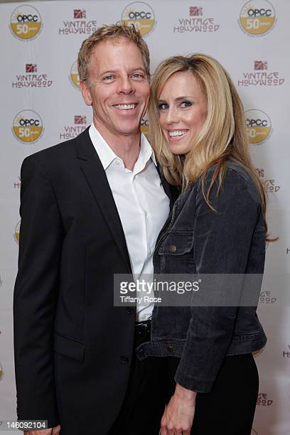 Actor Greg Germann and Martha Champlin attend the Vintage Hollywood Fundraiser for Ocean Park Community Center at David Arquette's home on June 9...