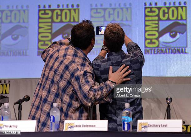 Actor Greg Grunberg and writer/producer Tim Kring take a selfie onstage at the Heroes Reborn exclusive extended trailer and panel during ComicCon...