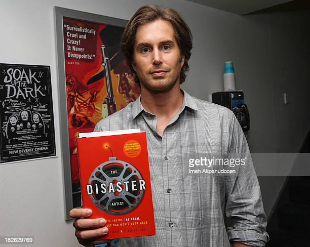 Actor Greg Sestero poses before signing copies of his new book 'The Disaster Artist' at New Beverly Cinema on October 1 2013 in Los Angeles California