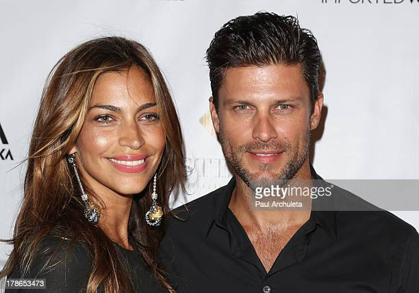 Actor Greg Vaughan and his wife Touriya Vaughan attend the Genlux Magazine release party at Sofitel Hotel on August 29 2013 in Los Angeles California