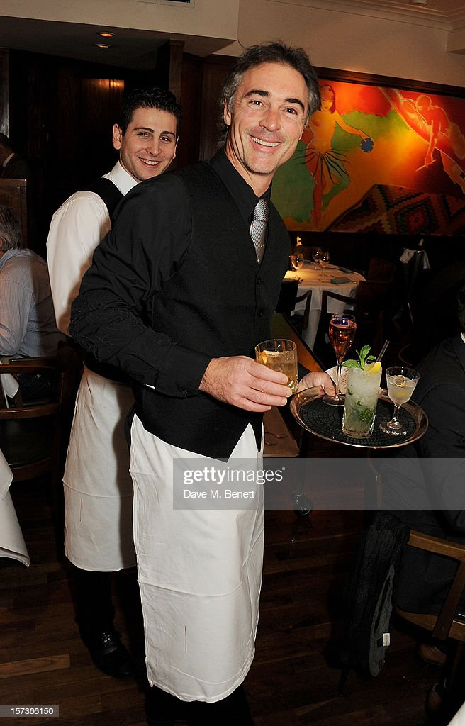 Actor Greg Wise, working as a waiter, attends One Night Only at The Ivy, featuring 30 stage and screen actors working as staff during dinner at The Ivy, in aid of The Combined Theatrical Charities, on December 2, 2012 in London, England.