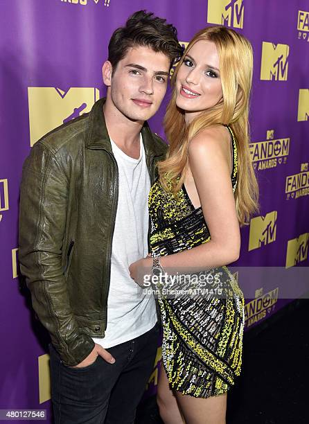 Actor Gregg Sulkin and host Bella Thorne attend the MTV Fandom Awards San Diego at PETCO Park on July 9 2015 in San Diego California