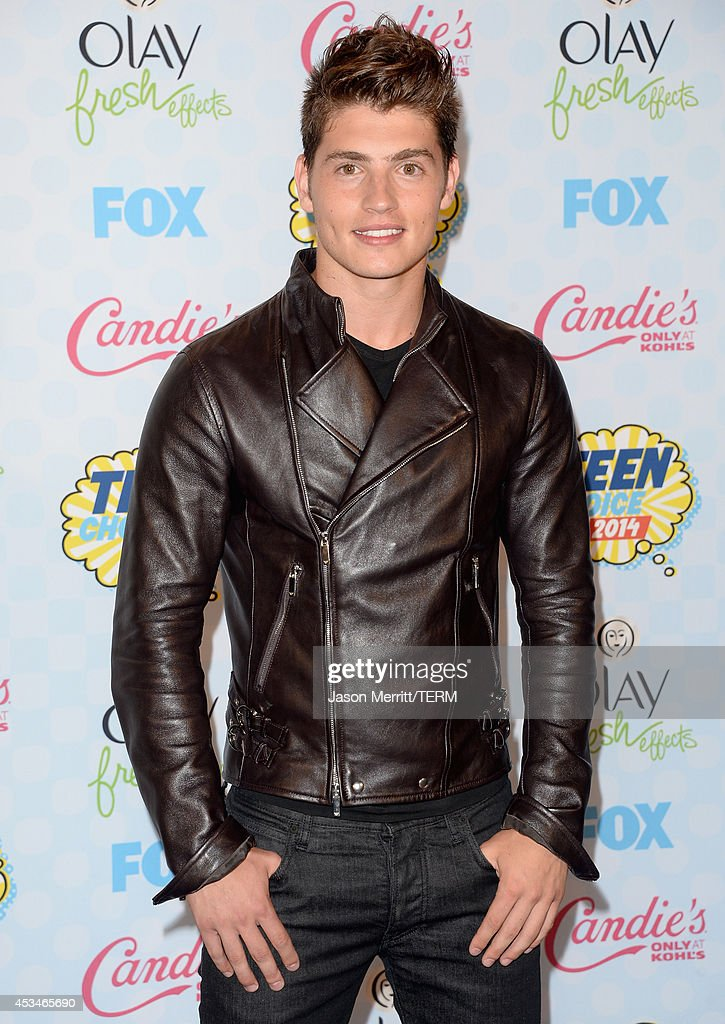 Actor Gregg Sulkin poses in the press room at FOX's 2014 Teen Choice Awards at The Shrine Auditorium on August 10, 2014 in Los Angeles, California.