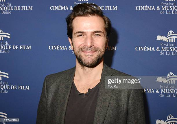 Actor Gregory Fitoussi poses at the photcall of ÒDemain Tout CommenceÓ La Baule Premiere at the Gulf Stream Cinema during the'Cinema Et Musique De...