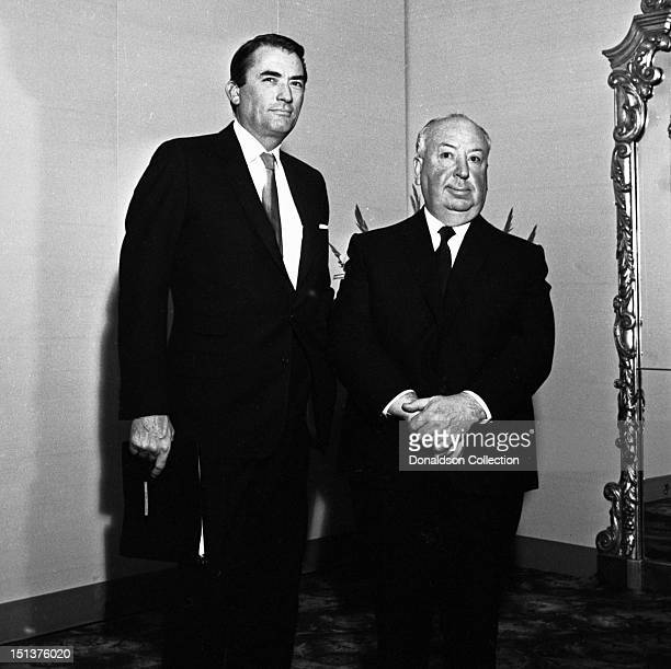 Actor Gregory Peck and director Alfred Hitchcock pose for a portrait at a dinner for the Motion Picture Pioneers Association at the Playboy Club on...