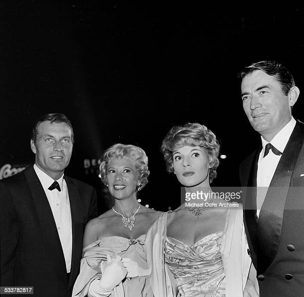 """Actor Gregory Peck and his wife Veronique Passani with actor George Montgomery and singer Dinah Shore attend the premiere of """"The Big Country"""" in Los..."""