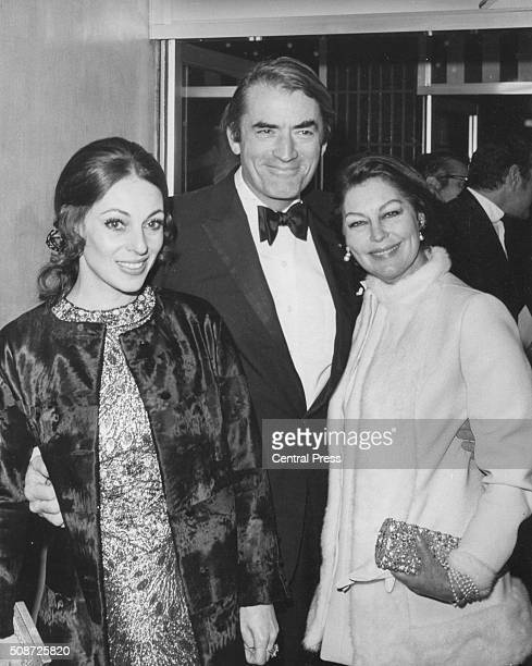 Actor Gregory Peck and his wife Veronique Passani with actress Ava Gardner at the premiere of the film 'Marooned' at the Odeon in Leicester Square,...