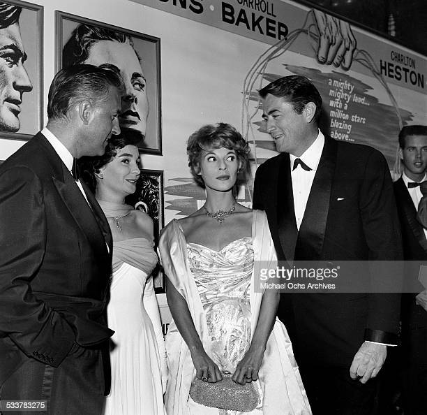 Actor Gregory Peck and his wife Veronique Passani with actress Jean Simmons and Stewart Granger attend the premiere of The Big Country in Los...