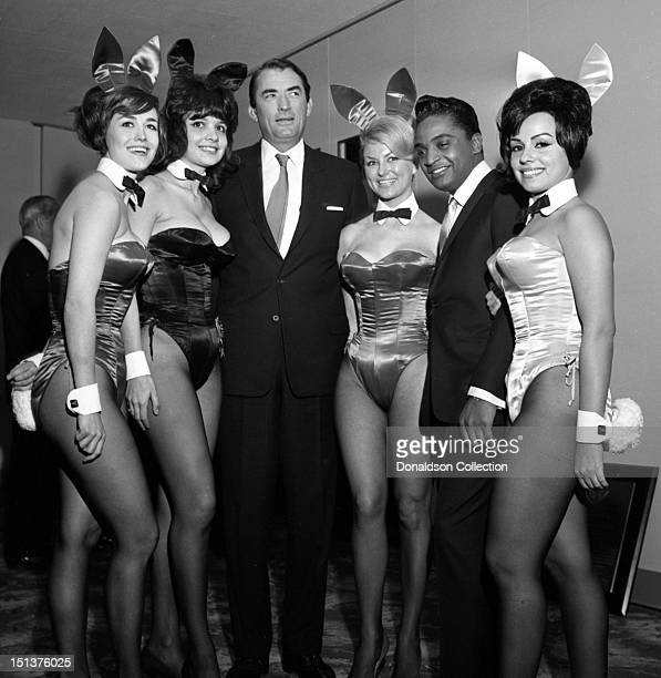 Actor Gregory Peck and rock and roll singer Jackie Wilson pose for a portrait with a group of Playboy Bunnies at a dinner for the Motion Picture...