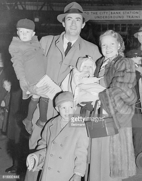 Actor Gregory Peck and wife Greta pose with their three sons. Gregory holds Stephen, Greta holds Carey, and Jonathan is at bottom.