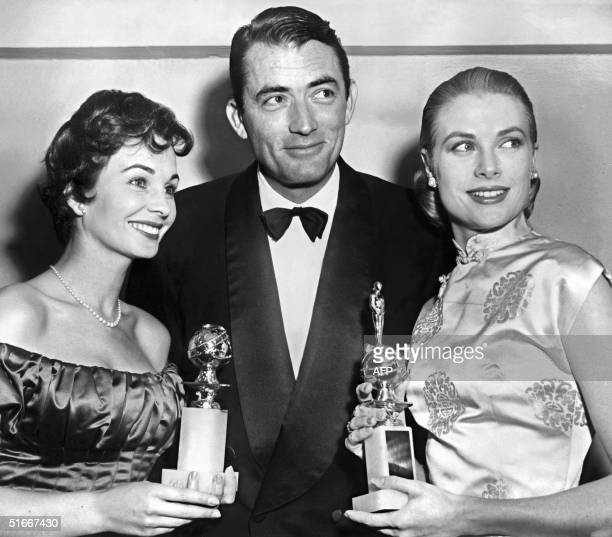 "Actor Gregory Peck is surrounded 23 February 1956 by Grace Kelly , awarded Favorite Actress for ""Henrietta"" and Jean Simmons, named Best actress in a..."