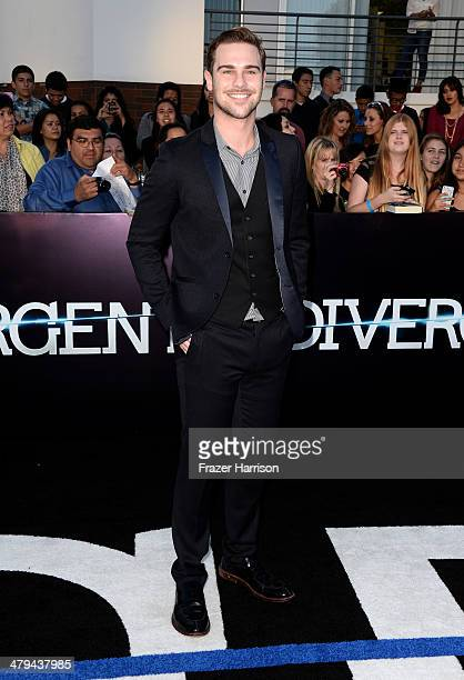 Actor Grey Damon arrives at the premiere of Summit Entertainment's Divergent at the Regency Bruin Theatre on March 18 2014 in Los Angeles California