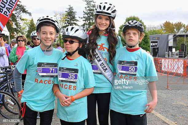 Actor Griffin Gluck and Miss Teen USA K. Lee Graham pose with Buddies at the 2014 Audi Best Buddies Challenge on October 18, 2014 in Washington, DC.