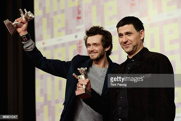 Actor Grigory Dobrygin and actor Sergei Puskepalis pose with the Silver Bear for Best Actor of 'Kak ya provel etim letom' at the 'Award Winners'...