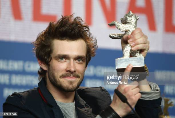 Actor Grigory Dobrygin poses with the Silver Bear for Best Actor of 'Kak ya provel etim letom' at the 'Award Winners' Press Conference during day ten...