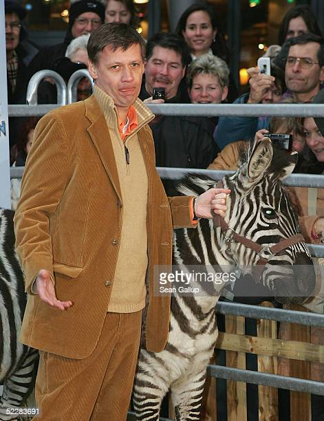 """Actor Guenther Jauch poses with a zebra at the German premiere of """"Racing Stripes"""" on March 6, 2005 in Berlin, Germany."""