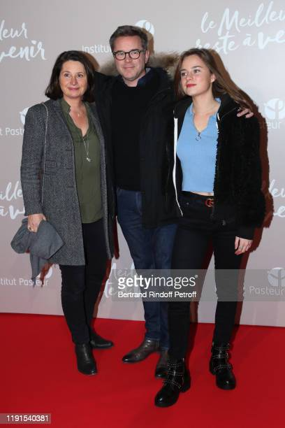 Actor Guillaume de Tonquedec satnding brtween his wife Christelle de Tonquedec and their daughter Victoire de Tonquedec attend the Le Meilleur reste...