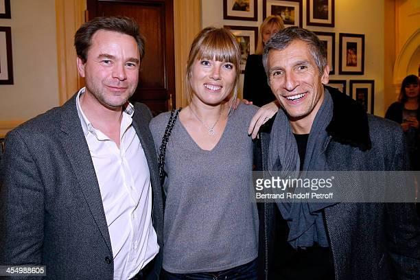 Actor Guillaume de Tonquedec TV presenter Nagui and his wife actress Melanie Page attend the FrançoisXavier Demaison show 'Demaison S'Evade' Premiere...