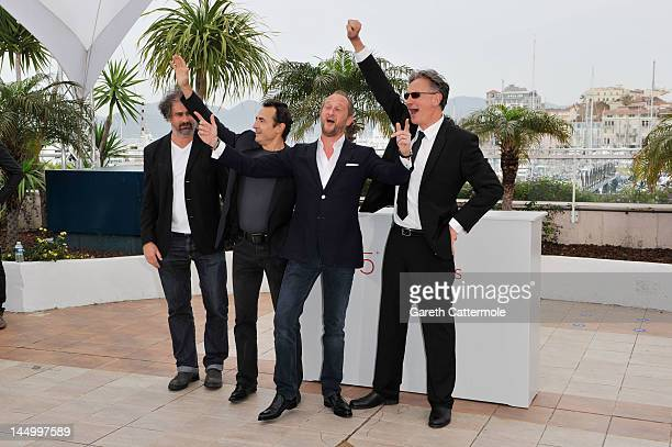 Actor Gustave Kerven actor Albert Dupontel actor Benoit Poelvoorde and director Benoit Delepine pose at the 'Le Grand Soir' photocall during the 65th...