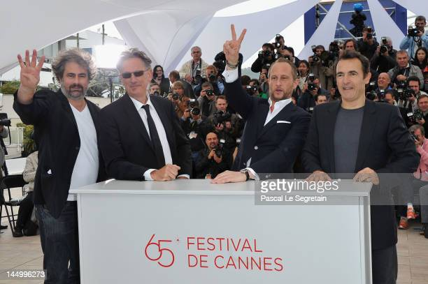Actor Gustave Kerven director Benoit Delepine actor Benoit Poelvoorde and actor Albert Dupontel pose at the 'Le Grand Soir' photocall during the 65th...