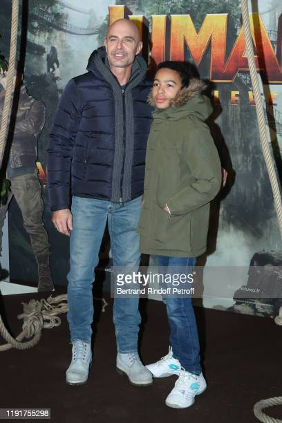 Actor Guy Amram and his son Sacha Amram attend the photocall of the Jumanji Next Level film at le Grand Rex on December 03 2019 in Paris France