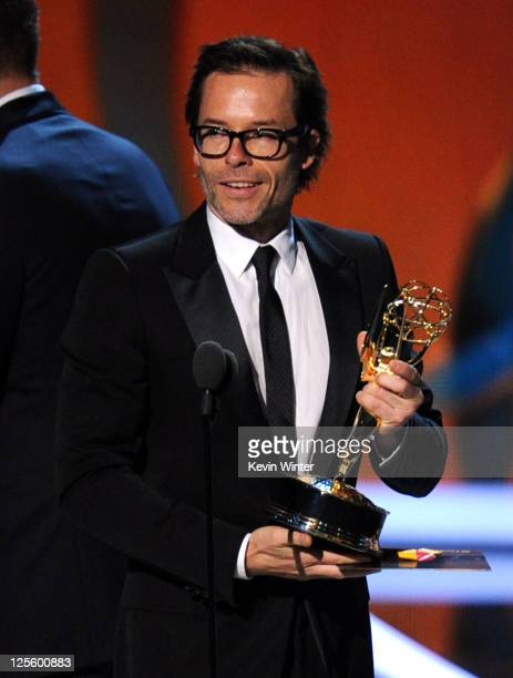 Actor Guy Pearce accepts the Outstanding Supporting Actor in a Miniseries or Movie award onstage during the 63rd Annual Primetime Emmy Awards held at...