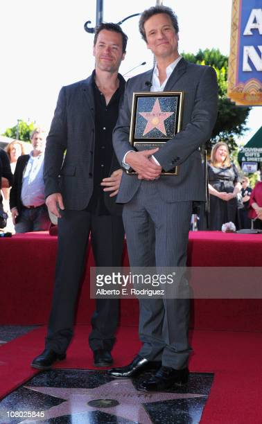Actor Guy Pearce and actor Colin Firth attend a ceremony honoring Colin Firth with the 2429th Star on The Hollywood Walk of Fame on January 13 2011...