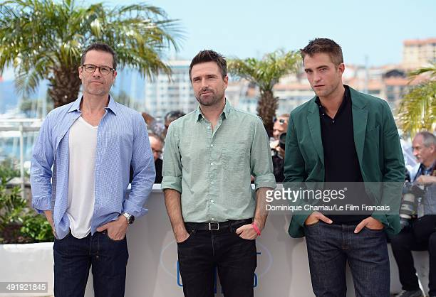Actor Guy Pearce director David Michod and actor Robert Pattinson attend 'The Rover' photocall at the 67th Annual Cannes Film Festival on May 18 2014...