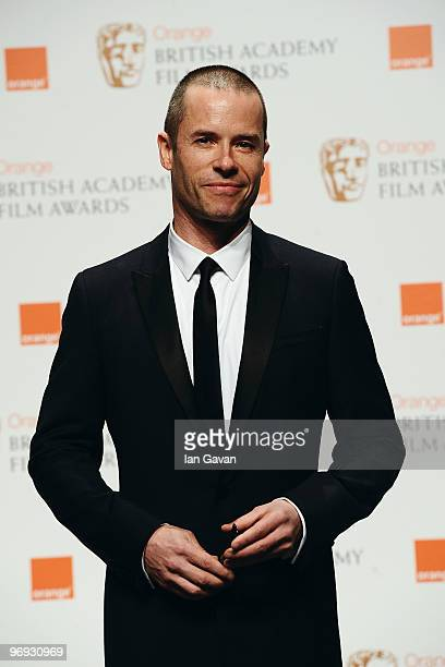 Actor Guy Pearce poses during the Orange British Academy Film Awards 2010 at the Royal Opera House on February 21 2010 in London England