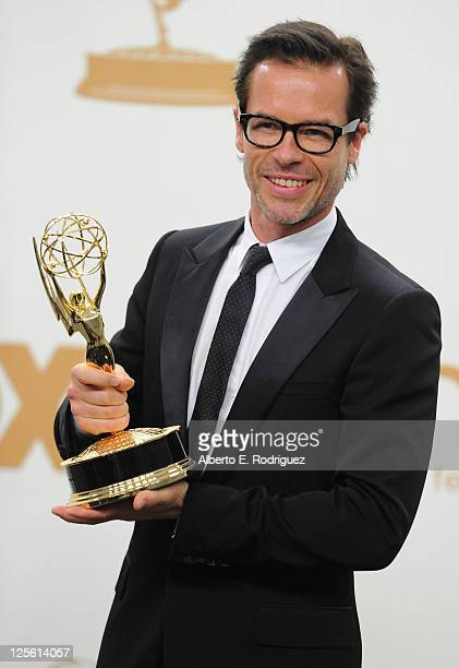 Actor Guy Pearce poses in the press room during the 63rd Annual Primetime Emmy Awards held at Nokia Theatre LA LIVE on September 18 2011 in Los...