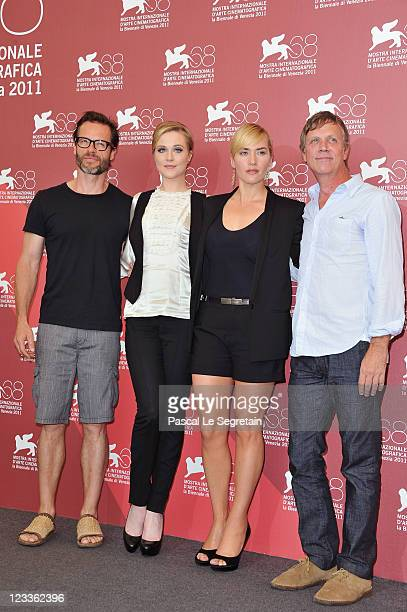 Actor Guy Pearce with actresses Evan Rachel Wood and Kate Winslet and director ToddHaynes poses at the Mildred Pierce photocall at the Palazzo del...